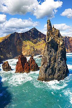Majestic pinnacle of sea stack rock hit by waves, Sao Lourenco viewpoint, Canical, Madeira island, Portugal