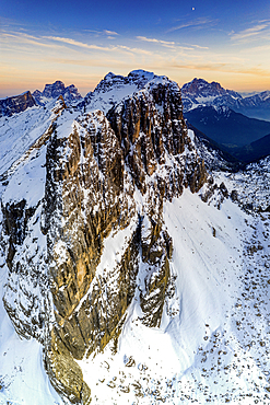 Aerial panoramic of majestic Nuvolau, Monte Pelmo and Civetta covered with snow at sunset, Dolomites, Veneto, Italy