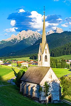 Church in the green landscape of alpine village of Villabassa (Niederdorf), Val Pusteria, Bolzano province, South Tyrol, Italy, Europe