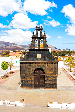 Black facade of St. Anne church built with basalt volcanic stones, Casillas del Angel, Fuerteventura, Canary Islands, Spain
