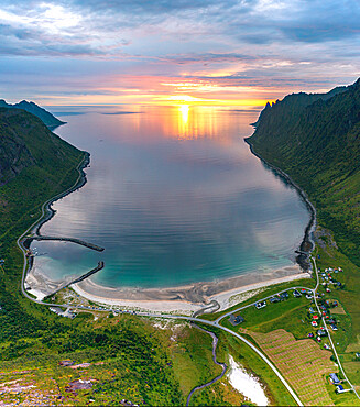 Midnight sun over Ersfjord beach overlooking the arctic sea, aerial view, Senja, Troms county, Norway