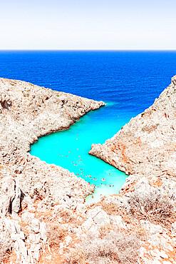 Beach of Seitan Limania washed by turquoise sea nestled inside rock canyons, Akrotiri peninsula, Chania, Crete, Greece