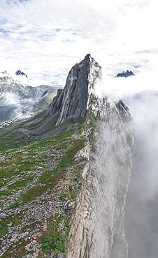 Aerial panoramic view of Mount Segla emerging from fog, Senja island, Troms county, Norway