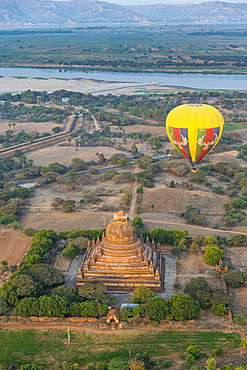 Hot air balloon at sunrise over a temple, Bagan (Pagan), Myanmar (Burma), Asia