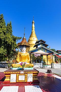 Buddha before the Golden stupa, Aung Zay Yan Aung Pagoda, Myitkyina, Kachin state, Myanmar (Burma), Asia