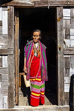 Chin woman with spiderweb tattoo smoking a pipe, Mindat, Chin state, Myanmar (Burma), Asia