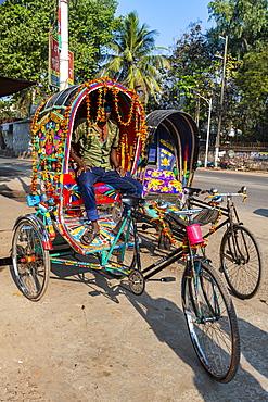 Man in his Rickshaw, Chittagong, Bangladesh, Asia