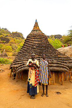 Traditional dressed young girls from the Laarim tribe before their hut, Boya hills, Eastern Equatoria, South Sudan