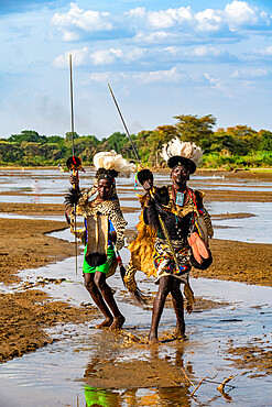 Men from the Toposa tribe posing in their traditional warrior costume, Eastern Equatoria, South Sudan, Africa