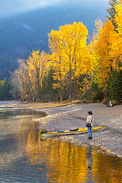 Woman on the shore of Lake McDonald, Glacier National Park, Montana, United States of America, North America