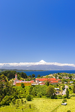 View over the church to lake Llanquihue and Volcan Osorno, Puerto Varas, Chilean Lake District, Los Lagos, Chile, South America