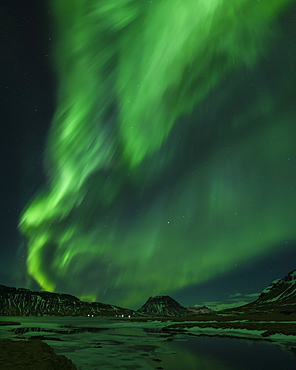 Aurora borealis (Northern Lights) and partially frozen lake, North Snaefellsnes, Iceland, Polar Regions