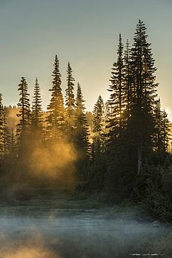 Morning sunlight and mist, Reflection Lake, Mount Rainier National Park, Washington State, United States of America, North America