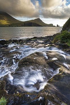 Stream leading into Sorvags Fjord, Bour, Vagar Island, Faroe Islands, Denmark, Atlantic, Europe
