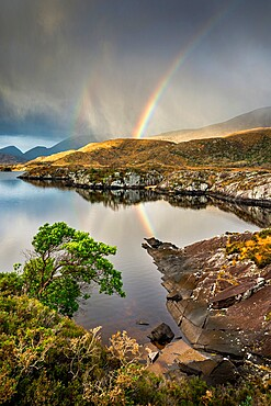 Rainbow and rain clouds over Upper Lake, Killarney National Park, County Kerry, Munster, Republic of Ireland, Europe