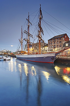 An atmospheric dusk at Sutton Harbour and the Barbican, the historic and tourism heart of the city of Plymouth, Devon, England, United Kingdom, Europe