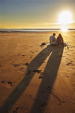 A sunset picnic on the beach, Westward Ho!, north Devon, England, United Kingdom, Europe