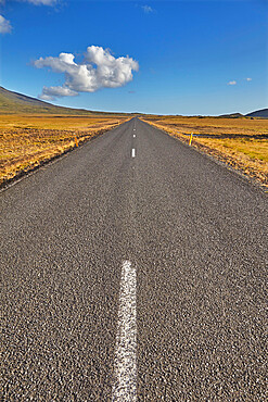 An arrow-straight road cuts across a lava field; in Snaefellsjokull National Park, Snaefellsness peninsula, western Iceland.
