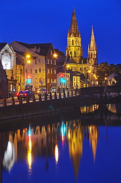 A dusk view of St. Fin Barre's Cathedral, on the banks of the Lee River, in Cork, County Cork, Munster, Republic of Ireland, Europe