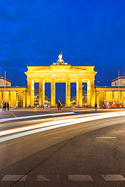 Light trails by Brandenburg Gate at night in Berlin, Germany, Europe