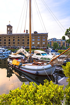 Boats moored at St. Katherine Docks, London, England, Europe