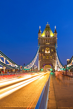 Light trails on Tower Bridge at sunset in London, England, Europe