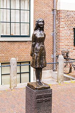 Statue of Anne Frank outside Westerkerk, Amsterdam, Netherlands, Europe