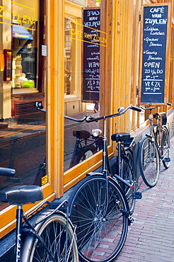Bicycles outside a cafe in Amsterdam, The Netherlands, Europe