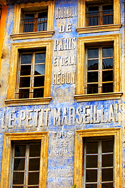 Old newspaper mural advert, Provence, France, Europe