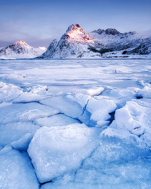 Frozen lake in front of mountain in the early morning light, Lofoten Islands, Nordland, Norway, Europe