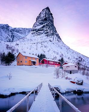 Famous pointed mountain of Reine at sunset, Reine, Lofoten Islands, Nordland, Norway, Europe