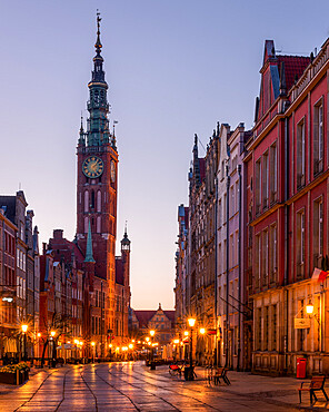 Dlugi Targ Street looking towards the clock tower of the museum at night, Gdansk, Poland, Europe