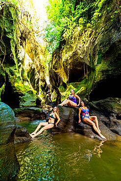 Women posing for a picture at the Beji Guwang Hidden Canyon, Bali, Indonesia, Southeast Asia, Asia