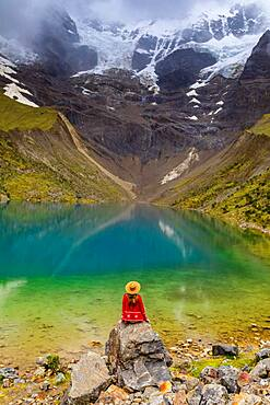 Woman enjoying the view of crystal clear Humantay Lake, Cusco, Peru, South America