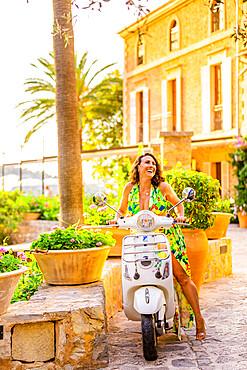 Woman enjoying the beautiful scenery in Mallorca.