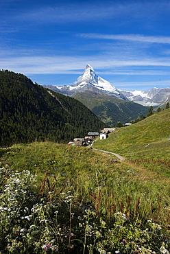 The classic Walkers Haute route from Chamonix to Zermatt the trail leads down into Zermatt with the Matterhorn ahead,  Swiss Alps, Switzerland, Europe