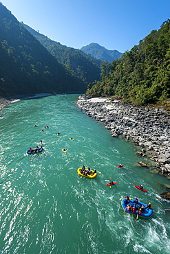 Rafts and kayaks drift down the Karnali River in west Nepal, Asia