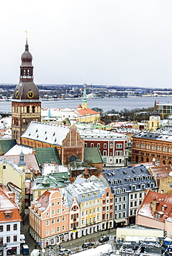View over Riga Old Town city centre and Daugava River, with snow covered rooftops, UNESCO World Heritage Site, Riga, Latvia, Europe