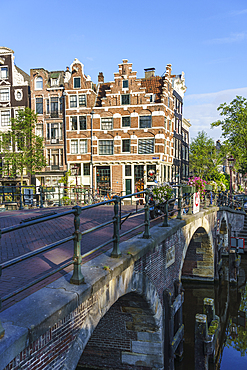 Old gabled buildings by a bridge on Prinsengracht, Amsterdam, North Holland, The Netherlands, Europe