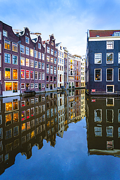 Old gabled buildings by a canal at dusk, Oudezijds Kolk, Amsterdam, North Holland, The Netherlands, Europe