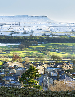 Askrigg village and snow capped Addlebrough in upper Wensleydale, The Yorkshire Dales, Yorkshire, England, United Kingdom, Europe - 1228-240