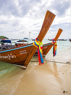 Long-tail boats with coloured-ribbon offerings, Ko Lipe, Thailand, Southeast Asia, Asia