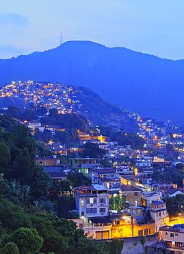 Twilight view of the favelas Unidos de Santa Teresa Morro do Escondidinho and Morro dos Prazeres, Rio de Janeiro, Brazil, South America