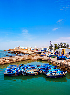 Cityscape with blue boats in the Scala Harbour and the Medina city walls, Essaouira, Marrakesh-Safi Region, Morocco, North Africa, Africa