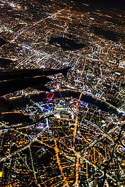 March 2019, London England. Views over London at night from an airplane window