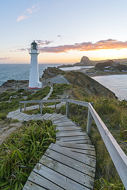 Castlepoint lighthouse and Castle Rock at sunset, Castlepoint, Wairarapa region, North Island, New Zealand, Pacific