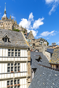 Houses in the village centre with the Abbey above, UNESCO World Heritage Site, Mont-Saint-Michel, Normandy, France, Europe