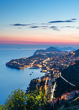 The city lights at sunset over the old town of Dubrovnik, UNESCO World Heritage Site, and the Dalmatian Coast, Croatia, Europe