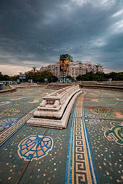An empty fountain and impending storm in Bucharest, Romania, Europe