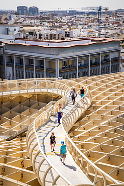 People on the elevated walking platform of Seville's Metropol Parasol, La Encarnacion Square, Seville, Andalusia, Spain, Europe